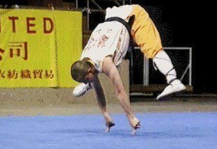 A shoalin monk performs a handstand on only two fingers in this animated gif