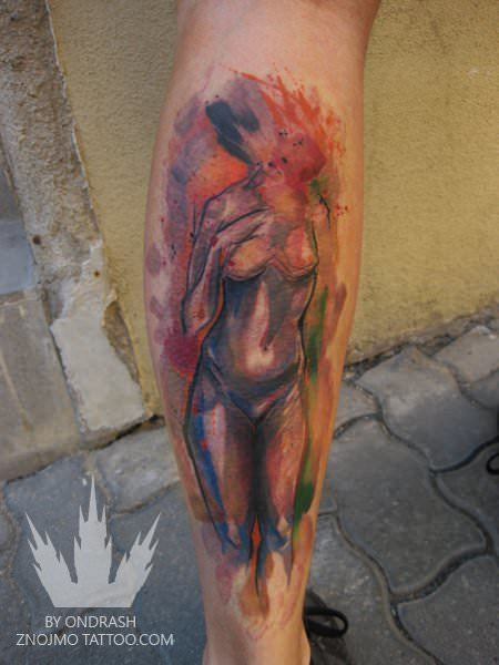 This artistic nude tattoo was created by the talented watercolor tattoo artist Ondrash