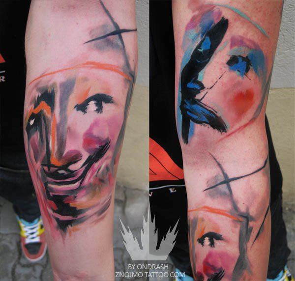 Happy and sad drama masks get a makeover in this colorful watercolor tattoo by Ondrash