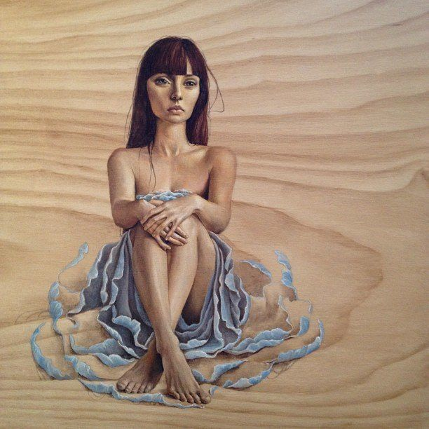 A wood painting by mandy Tsung of a beautiful woman surrounded by her skirts