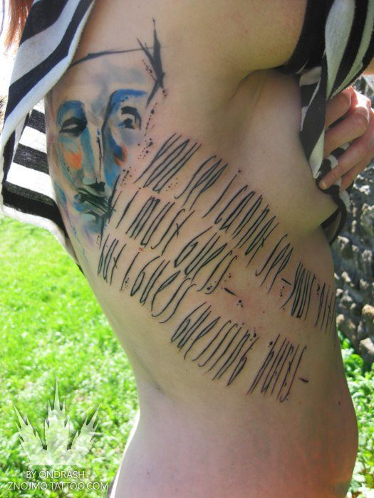 Poetry and painting merge with body art in this artistic watercolor tattoo by Ondrash