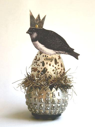 A mixed media art collage by Stephanie Rubiano combining a printed bird, egg and crown with real elements