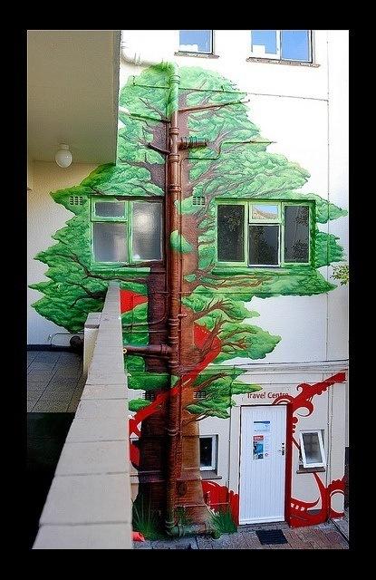Graffiti in Cape Town of a tree climbing an office block by Riyaan Shinjuku Wiener