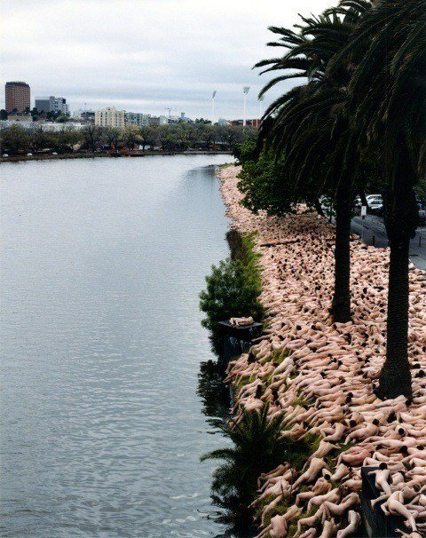 One of Spencer Tunick's mass nude photographs that uses thousands of volunteers to create a naked beach in Melbourne, Australia