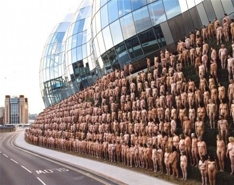 One of Spencer Tunick's mass nude photographs that uses thousands of volunteers to create a naked embankment in Newcastle