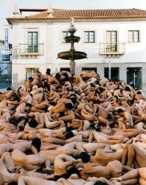 One of Spencer Tunick's mass nude photographs that uses thousands of volunteers to create a naked heap around a fountain in Portugal