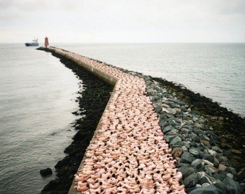 One of Spencer Tunick's mass nude photographs that uses thousands of volunteers to create a naked path in Dublin, Ireland