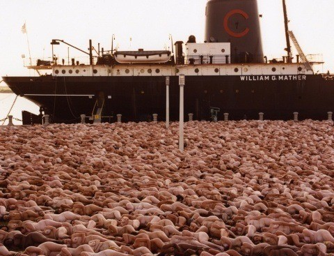 One of Spencer Tunick's mass nude photographs that uses thousands of volunteers to create a naked sea around a ship in Ohio, America