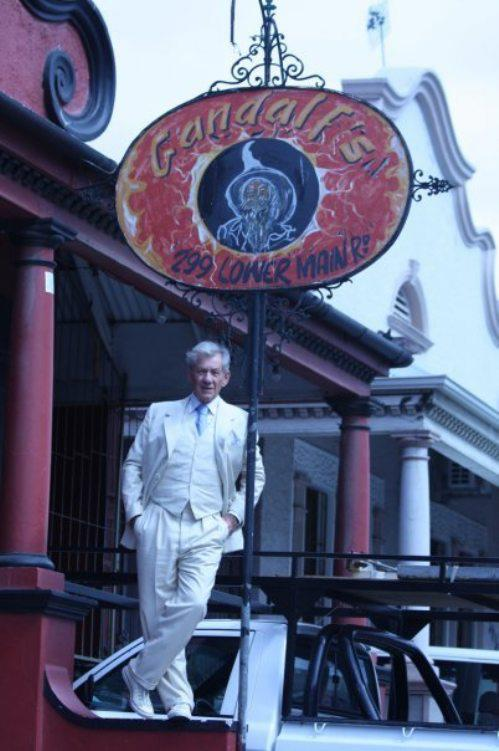 gandalfs bar gandalf the grey ian mckellan actor standing below sign funny irony