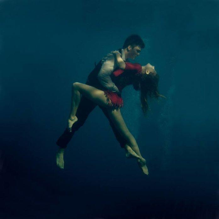 A Katerina Bodrunova photograph of a sexy couple dancing the tango underwater
