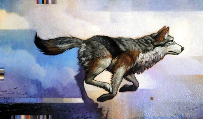 A native American inspired painting of a running wolf totem animal by Craig Kosak