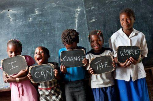 An inspirational photo of poor African kids holding up signs that spell I Can Change the World