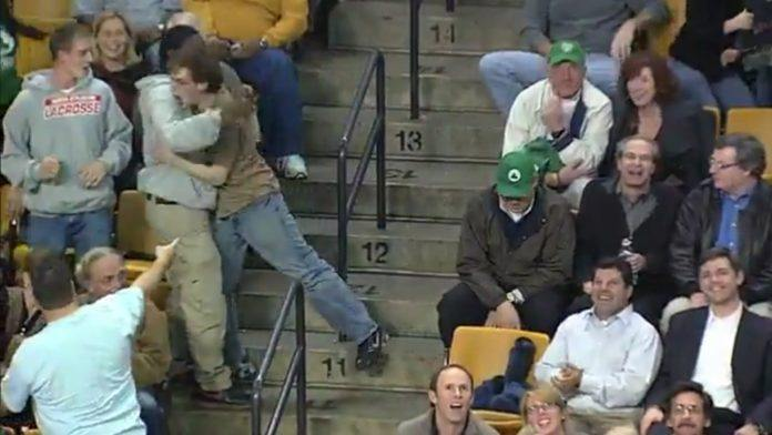 Bon Jovi fan Jeremy Fry hugs random dudes during his legendary spontaneous dance at a Celtics game