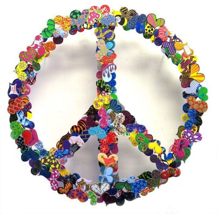This metal sculpture art work by David Kracov uses colorfully painted hearts to create a peace sign
