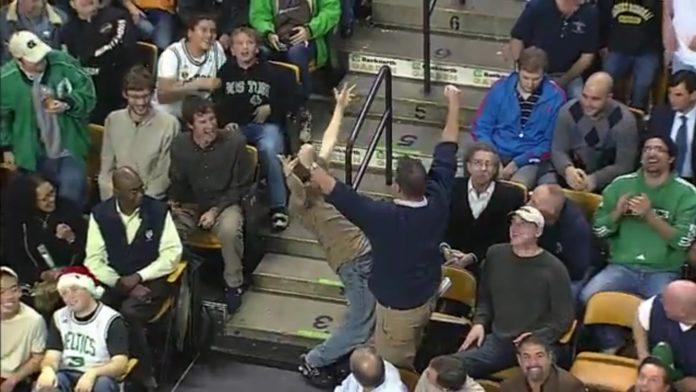 While dancing to Livin on a Prayer by Bon Jovi, Jeremy Fry starts interacting with other Celtics team fans