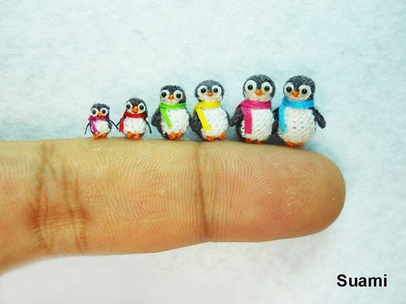 A collection of tiny miniature pengiuns that are use to decorate dollhouse rooms with stuffed animals by artist suami