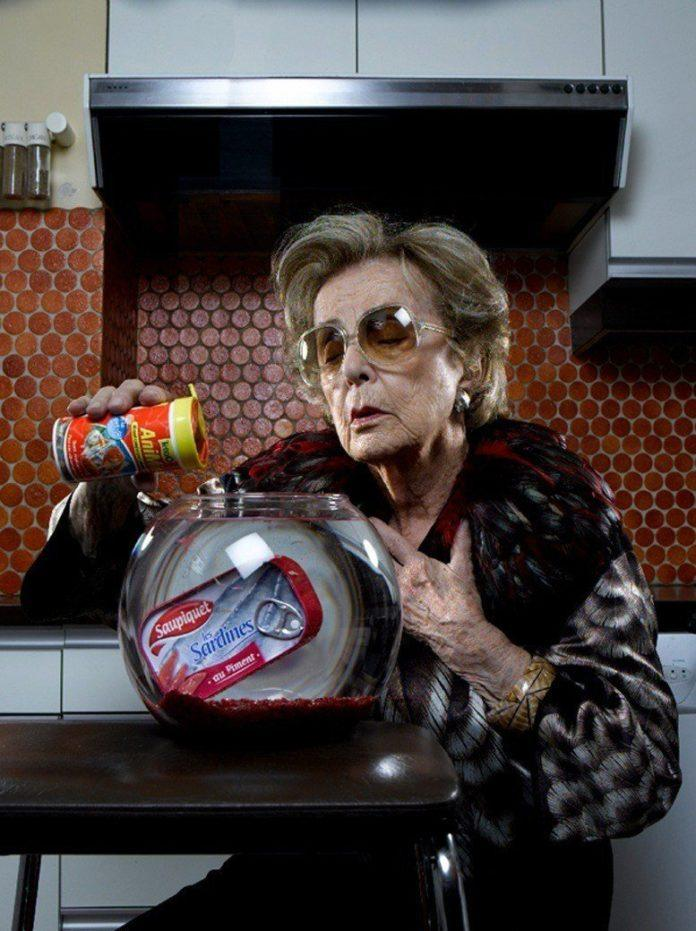 A funny photo by Sacha Goldberger of his grandmother feeding a tin of sardines fish food