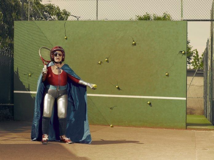 A funny photo by Sacha Goldberger of his grandmother in a superhero outfit playing tennis