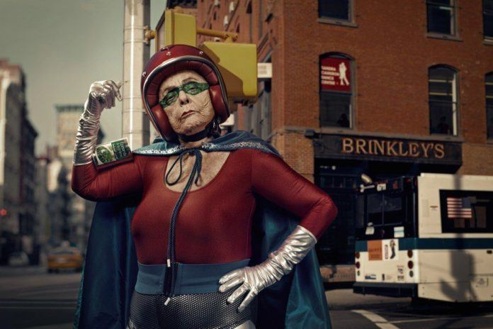 A funny photo by Sacha Goldberger of his grandmother in a superhero outfit posing like one tough old girl