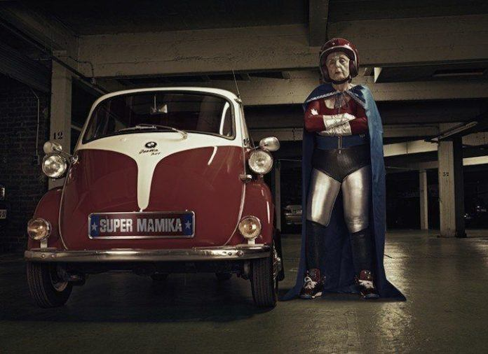 A funny photo by Sacha Goldberger of his grandmother in a superhero outfit posing like one tough old lady