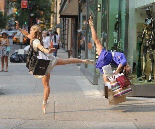 A funny photo of two girls shopping in ballet shoes dancing like ballerinas