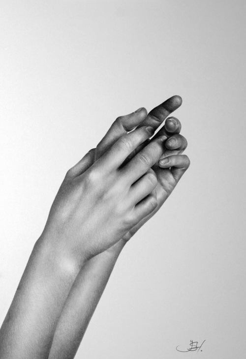 An amazing photorealistic pencil drawing by Ileana Hunter of a woman's hands