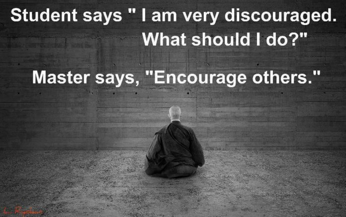 An inspirational picture quote about encouraging others to inspire and encourage yourself