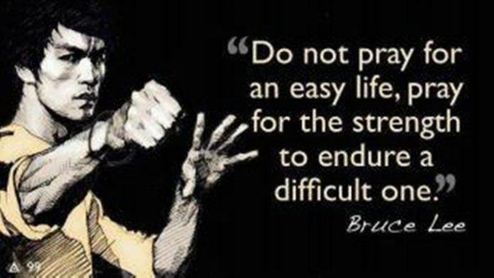 An inspirational picture quote of Bruce Lee talking about an easy life and a difficult one