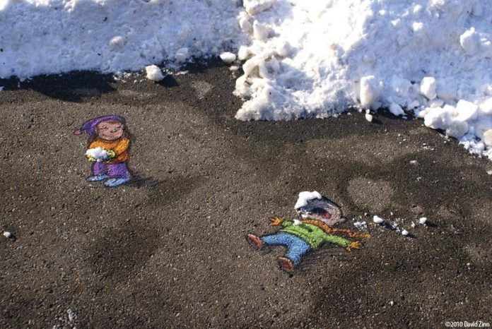 A funny graffiti chalk drawing by David Zinn of a little girl knocking a boy out with a snowball
