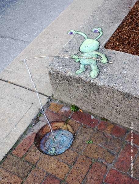 Sluggo the alien goes fishing in this sidewalk chalk graffiti drawing by David Zinn