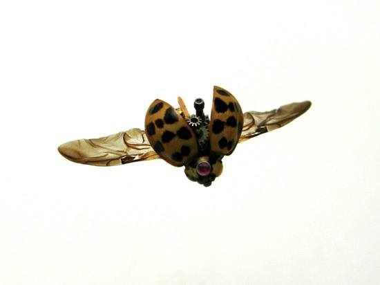 A cute steampunk ladybug sculpture by the insect lab that uses natural design and clockwork parts