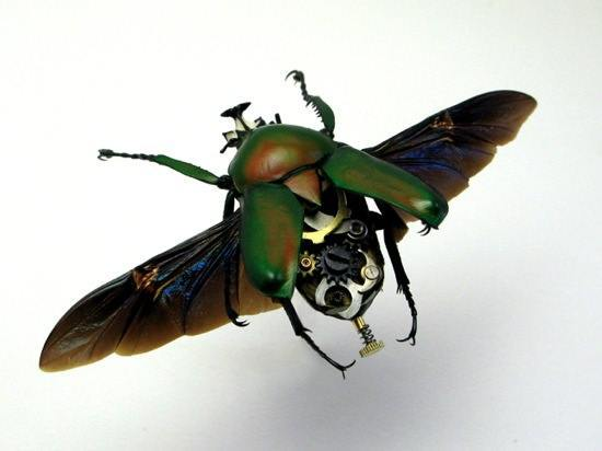 A green beetle has clockwork parts in this steampunk sculpture by the Insect Lab