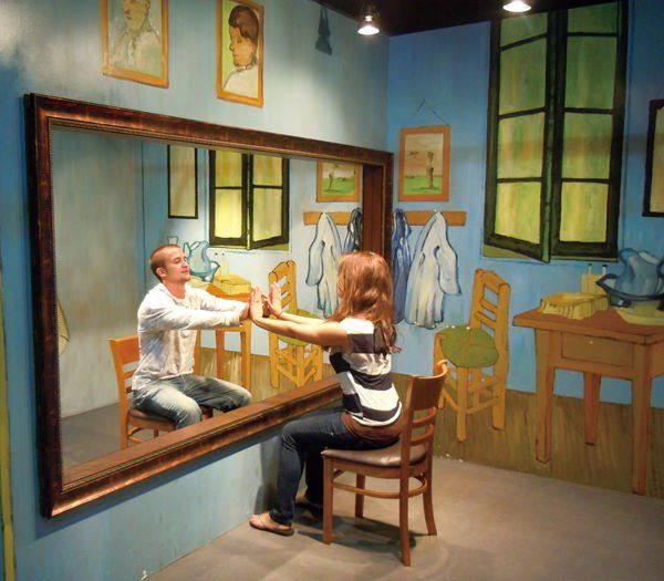 A man and woman appear in a van Gogh painting in this interactive optical illusion in Korea