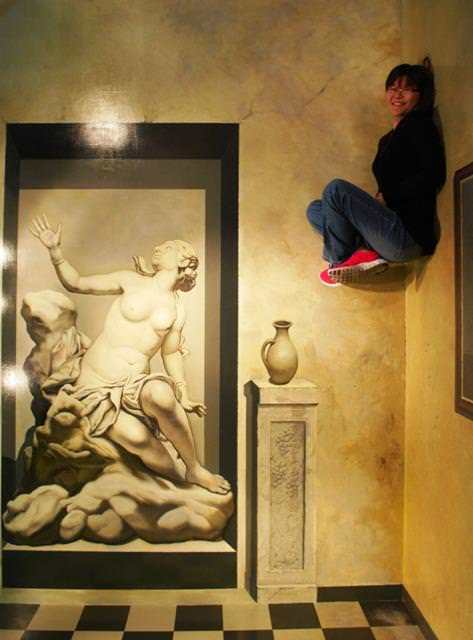 A woman appears to float in midair in this interactive optical illusion at the Trick Art museum in Kore
