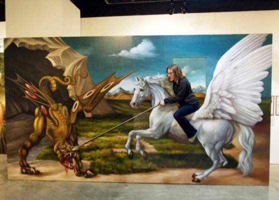 An interactive optical illusion at the Korean Trick Art Museum puts this girl in the centre of a fantasy scene with a pegasus and a dragon