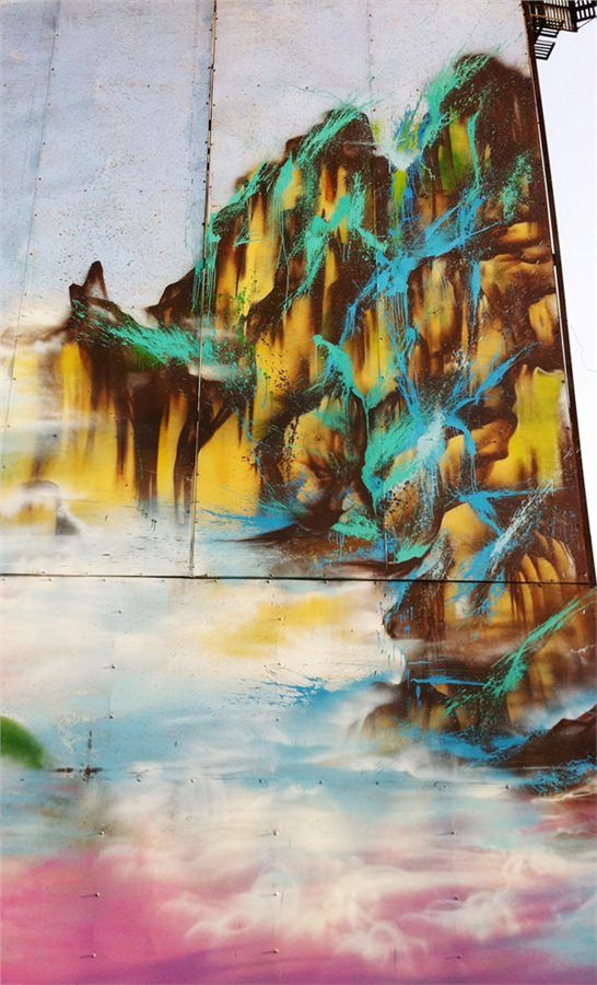 A building in China transforms into a misty mountain scene in this graffiti painting by hua Tunan