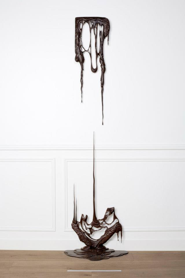 A melted wood picture frame falls to the floor in this Bonsoir Paris surrealism art work