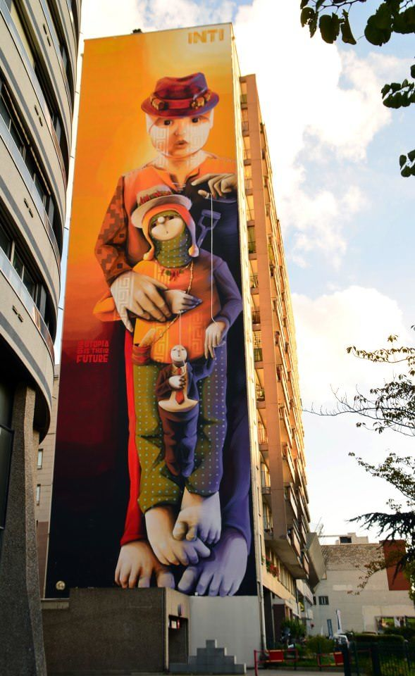 A mother and child appear together in this enormous graffiti painting by street artist Inti