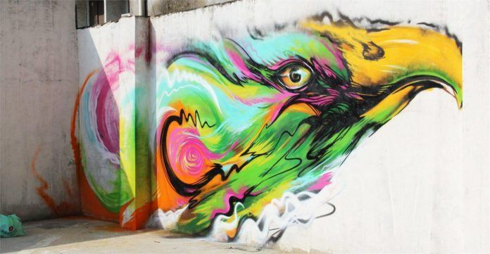 An eagle takes flight on a wall in China in this graffiti painting by hua Tunan