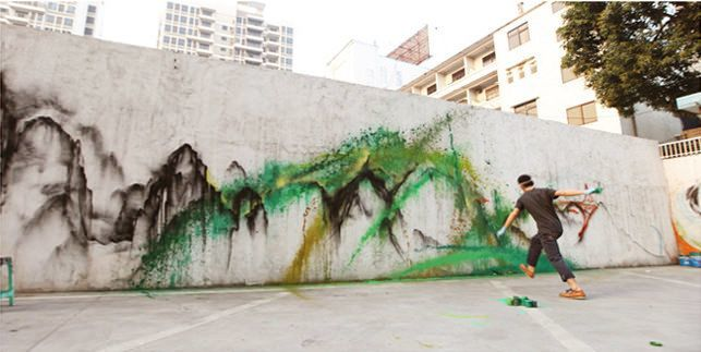 Chinese graffiti artist Hua Tunan flings paint at a wall to create a splatter effect
