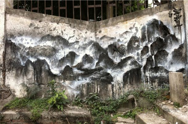 Chinese graffiti artist Hua Tunan turns this overgrown street corner into a mountain view
