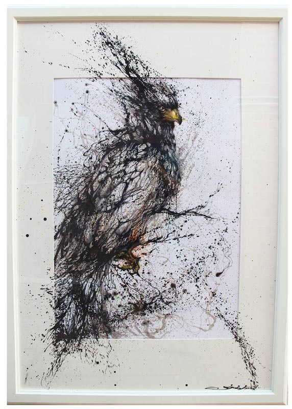 Chinese graffiti artist and painter Hua Tunan creates a bird of prey out of splattered ink