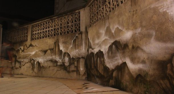 Graffiti artist Hua Tunan creates a subtle abstract landscape on this wall in China