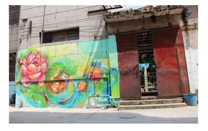Lotus flowers dance in this beautiful graffiti painting by Hua Tunan