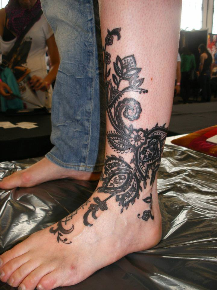 Paisley henna flowers become permanent body art in this for Henna body tattoo