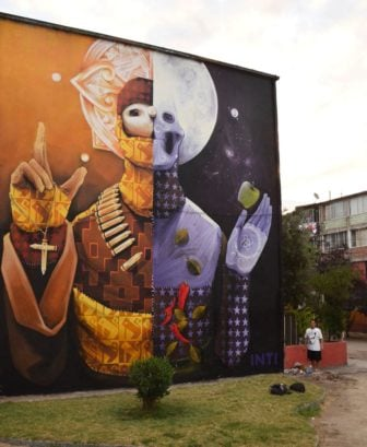 This fantastic and unusual graffiti painting by Inti challenges religion and technology