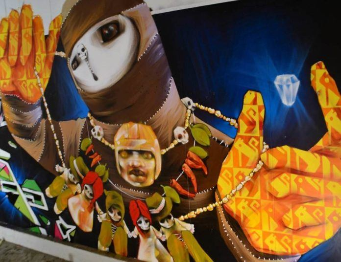 This large graffiti painting by Inti has distinct South American influences