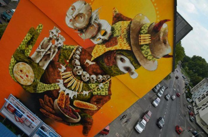Traditional South American symbols appear in this enormous graffiti painting by Inti