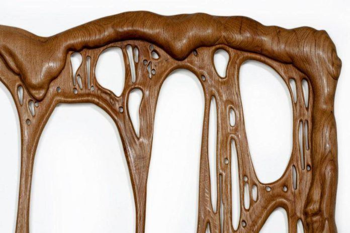 Wood tears like hot toffee in this surreal melting wood sculpture by French artist Bonsoir Paris