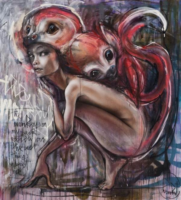 A beautiful nude girl poses with a monkey on her back in this graffiti painting by Herakut